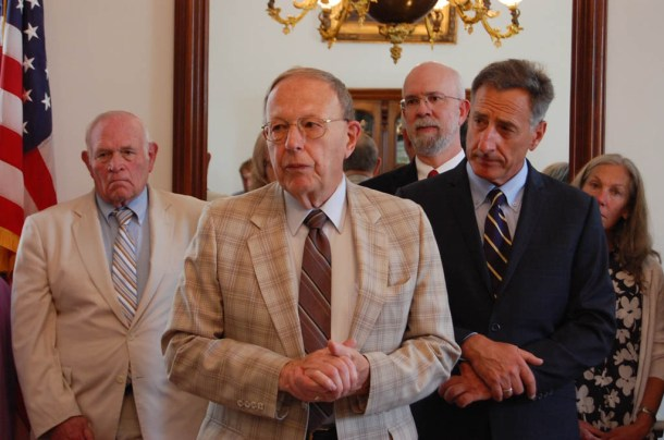 Retiring Rep. Tom Koch (center), R-Barre Town, joins Gov. Peter Shumlin at a series of criminal justice bill signings Tuesday in Montpelier. Photo by Laura Krantz/VTDigger