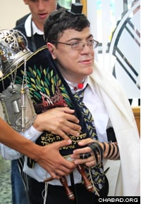 Andrew Lindhardt carried the Torah through the synagogue for the congregants to touch or kiss.