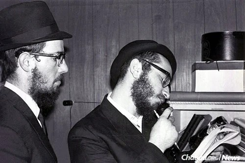 Wolff, right, and Chaim Baruch Halberstam working on the January broadcast. (Photo: Mulik Rivkin Archive)