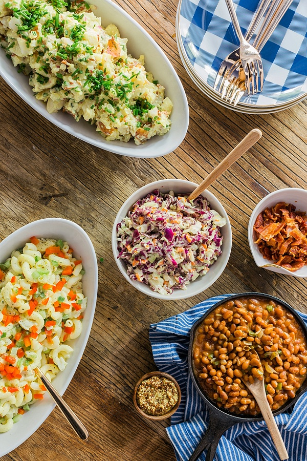 Homemade coleslaw, potato salad, macaroni salad and skillet baked beans recipe for Memorial Day BBQ party