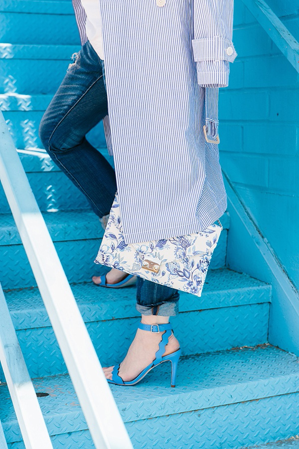 Light blue striped trench coat and floral envelope clutch, Waiting on Martha