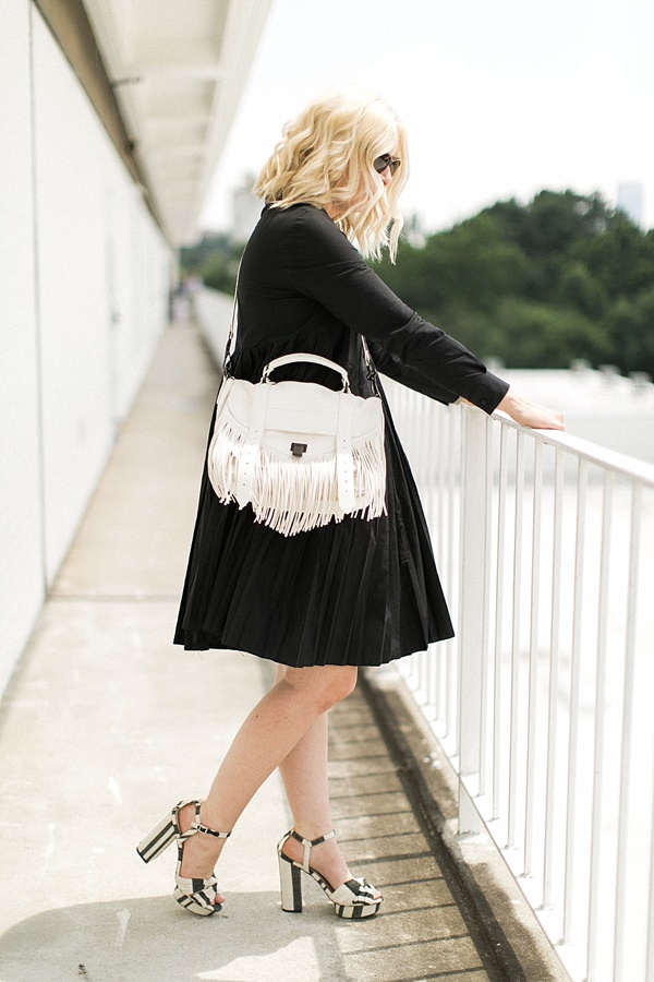 White fringe bag with black dress, Waiting on Martha