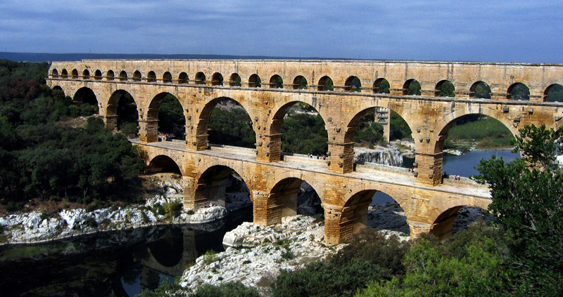 The romans knew how to move around water using gravity. Here's the aqueduct Pont du Gard from around 40AD.