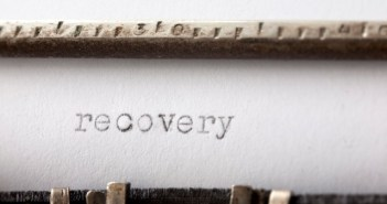 Recovery written on rusty and old typewriter. Shallow DOF macro shot.