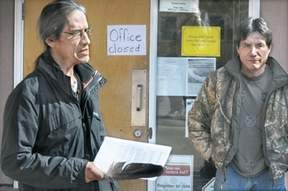 Rocky Tomma, with his brother Ron Tomma, stands outside the Little Shuswap Indian Band administration office Monday.