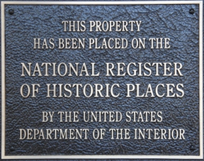 Plaque says: This property has been placed on the Nation Register of Historic Places by the United States Department of the Interior
