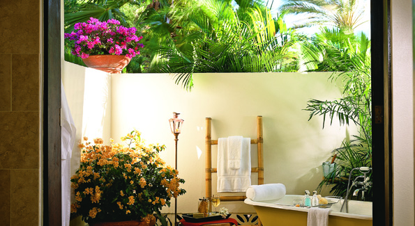 Jumby Bay's Rondavel Suites offer large outdoor bathrooms which feature an outdoor shower and bathtub.