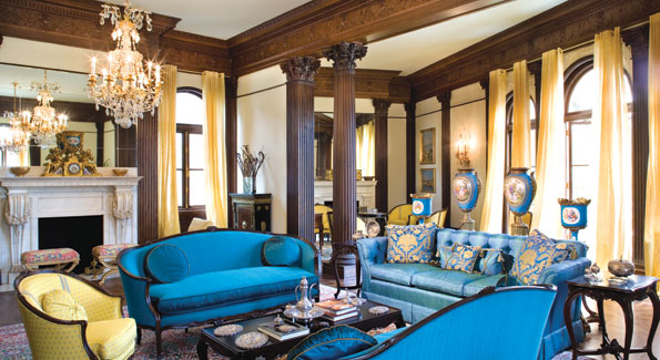 """The turquoise and yellow drawing room is now light and airy with silk and linen calm-yellow sheer drapery that let sunlight flood the room. The light also highlights the exquisite antique Serves vase collection - a main reason why turquoise has become """"the new neutral"""" for the mansion.  Note also the Ambassador's antique silver collection crafted by Turkish silversmiths in Istanbul."""