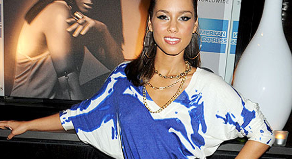 Alicia Keys wearing blue dress from Alexander McQueen 2010 Resort collection at her new album release in London