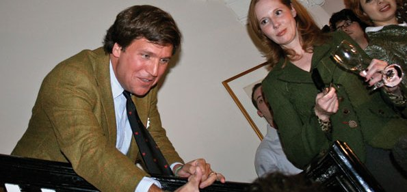 Tucker Carlson greets guest at his launch party as Juleanna Glover looks on.
