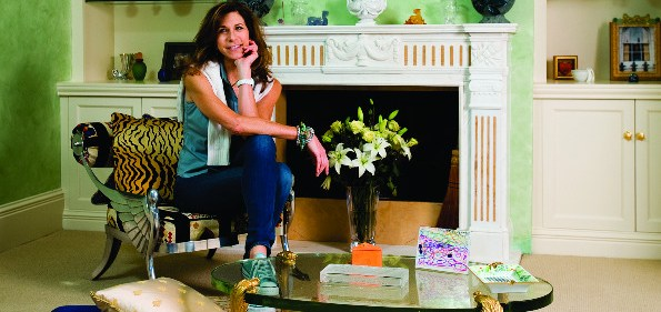 Lorie Peters Lauthier wears her signature Chuck Taylors in the sitting room of her master suite.  Photo by Joseph Allen.