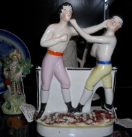 Staffordshire Group of John Heenan and Tom Sayers (England, ca. 1870, $1,850) from James M. Labaugh Antiques.