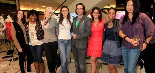 Michael Clements, founder of ArtJamz, poses with DC fashion bloggers. Photo by Marcus Bennett