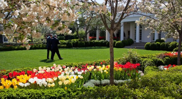 President Barack Obama walking through the Rose Garden of the White House with National Security Advisor Tom Donilon, April 14, 2011. Official White House Photo by Pete Souza.