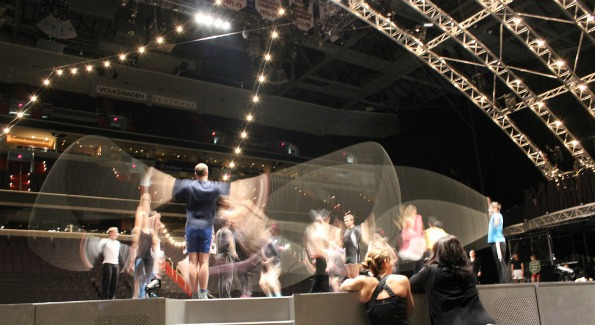 The cast of Cirque du Soleil's Quidam rehearses Tuesday onstage at the Verizon Center. Photo by John Arundel.
