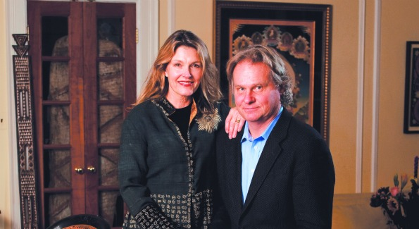 """Wade Davis and Gail Percy (Portrait by Joseph Allen): """"OurWashington is a city of green. Rock Creek running to the waterfront, the serenity of the towpath on an early spring morning, hidden reaches of the Potomac where we kayak alone through islands that change every season, even as the river itself never does.Add to this the beauty of National Cathedral, the sense of history in every neighborhood, the wild cacophony in the streets, voices from every corner of the world.What's not to love about a city that is home to the National Geographic, Smithsonian, Library of Congress and the National Archives, not to mention five great universities? We travel all the time, and what better gateways to the world could one ask for than Reagan Airport and Union Station."""""""