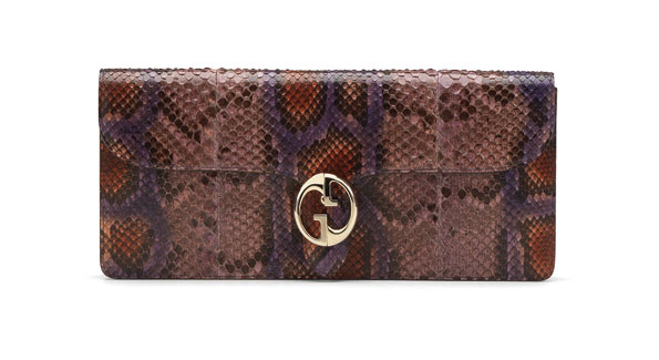 GUCCI????1973 grape color python clutch with double G detail. ($1,900); select Gucci stores, www. gucci.com