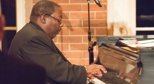 Jazz pianist Cyrus Chestnut delights the crowd at Evermay Mansion during a recent holiday concert. (Photo by Ben Powell)