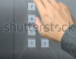 stock-photo-businessman-hand-press-open-door-button-in-elevator-73987459