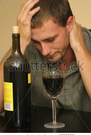 stock-photo-had-a-bad-day-man-drinking-wine-1950922