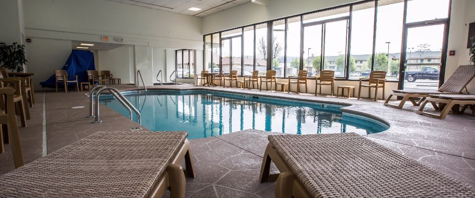 View of the Heated Indoor Pool from the foot of 2 Lounge Chairs at the Comfort Inn and Suites at Dollywood Lane in Pigeon Forge 960