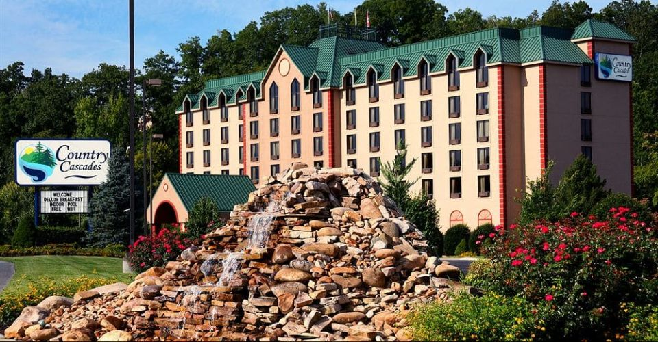 View of the Outside Front Entrance of the Country Cascade Resort in Pigeon Forge with Rock Water Feature 960