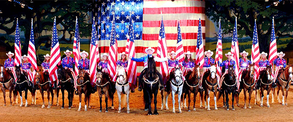 View of the American Flag and Riders at the Dixie Stampede in Pigeon Forge wide