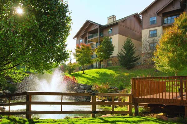Beauty of the grounds with a pool and fountain at the Wyndham Smoky Mountains