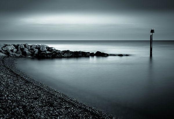 Last light on Ringstead Bay.
