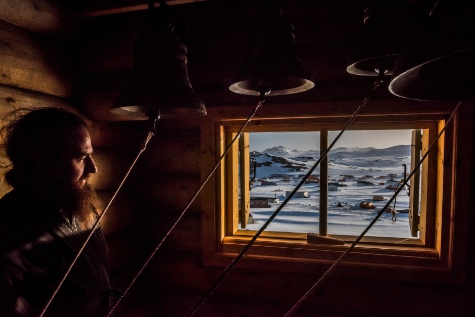 5. ANTARCTICA - DECEMBER 03, 2015: Priest, Father Benjam Maltzev looks on in the Bell room, after a vigil at the Russian Orthodox Church of the Holy Trinity on the 3rd of December, 2015 at the Bellingshausen Russian Antarctic research base in the Fildes Peninsula on King George Island, Antarctica.  More than a century has passed since explorers raced to plant their flags at the bottom of the world. But today, an array of countries are rushing to assert greater influence in Antarctica. Russia built the continent's first Orthodox church, pictured here, on a glacier-filled island with fjords and elephant seals. Less than an hour away by snowmobile, Chinese labourers have updated the Great Wall Station, a linchpin in China's plan to operate 5 bases on Antarctica. And India's futuristic new Bharathi base resembles a spaceship. The continent is supposed to be protected as a scientific preserve for decades to come, but many are looking toward the day those protective treaties expire — and exploring the strategic and commercial opportunities that exist right now.