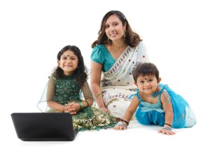 Traditional Indian family with laptop