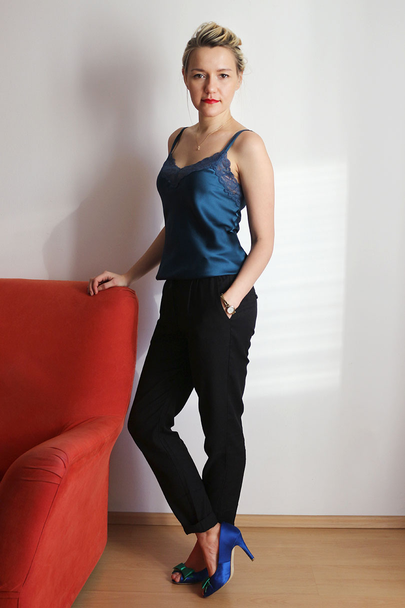 silk camisol and black trousers