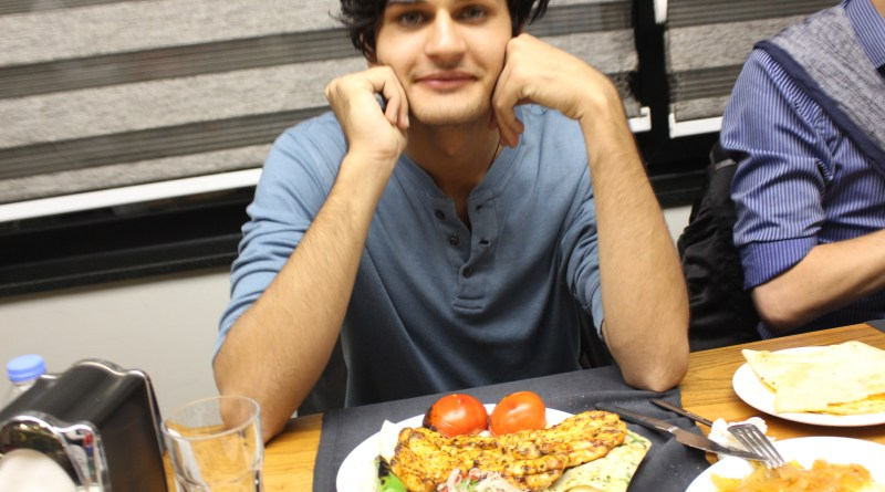 Faran posing before enjoying his meal.