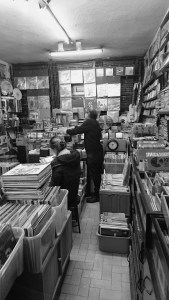After little chat with him, the customer who is new in listening the music on gramophone enters the store to buy some record.