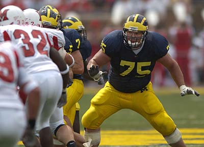 UM OL and offensive team captain David Baas (75) looks for a block.  GENERAL CAPTION -- Michigan beat Miami (Ohio) 43-10, taking advantage of seven Redhawk turnovers (five interceptions, two fumbles recovered) at Michigan Stadium on September 4, 2004 in the Wolverines' season opener.  (The Detroit News/John T. Greilick)