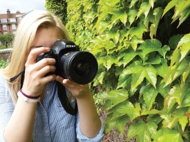 SIERRA HANCOCK / The Journal Sophomore photography major Gabrielle Deimeke takes pictures in Regent's Park of flowers. She is currently studying abroad in London at Regent's University. She has taken over 30,000 pictures since arriving there in January.  She started taking pictures when she was eight.