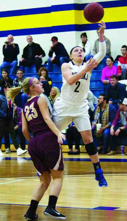 VICTORIA CASWELL/The Journal Ashley Brooks goes up for a layup in Webster's win over Eureka College.