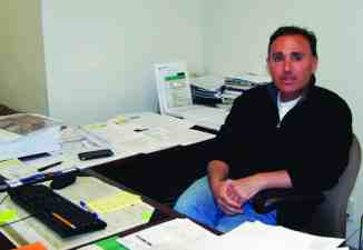 AMIE BOGGEMAN/ The Journal Women's Soccer Head Coach Luigi Scire in his office.