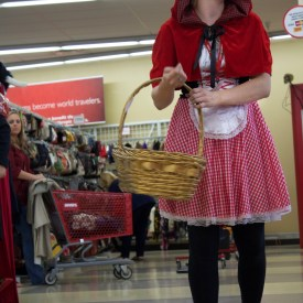 Savers employee Dana becomes Little Red Riding Hood and takes a stroll down Savers' Halloween costume catwalk. MIRANDA KENNY/The Journal