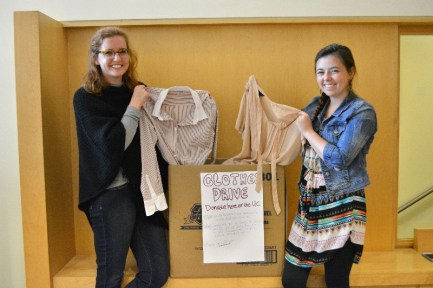 "Molly Kinder (left) and Jesse Steffens-Willis lead the professional clothing drive as part of the ""Living Generously"" keystone seminar.  JULIA PESCHEL / The Journal"