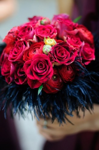 Blue feathers with red roses wedding bouquet