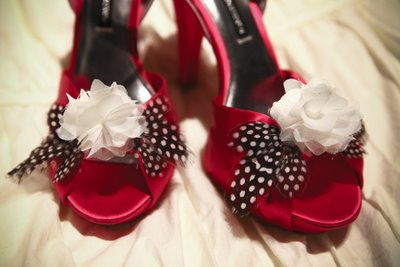 abby miller shoes in red with feathers and flowers