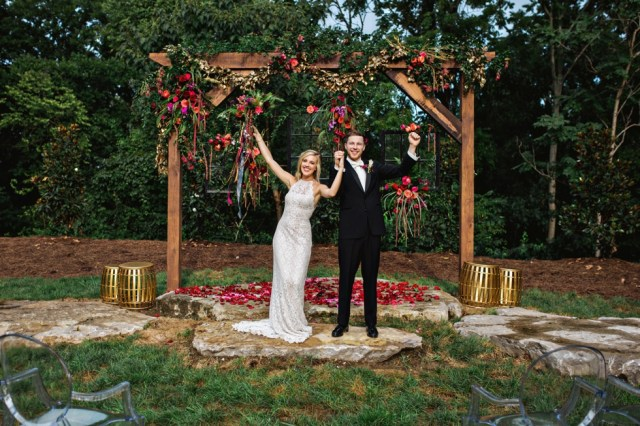 Luxe Bohemian Outdoor Wedding with hanging frames with florals
