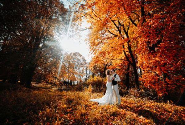 beautiful couple walking in the autumn lawn
