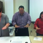 Arzel Bergeron, Damon Dupart, Monica Legendre demonstrate a fingerplay