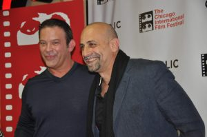 """Producer & director of """"One Day After Yesterday,"""" the Bogdanovich documentary, smile on their way into the screening."""