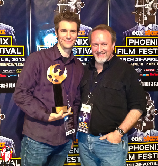 "Mark Stolaroff accepting Best Sci-Fi  Feature award for ""Pig"" from Int'l Horror and  Sci-Fi Program Director Michael Stackpole."