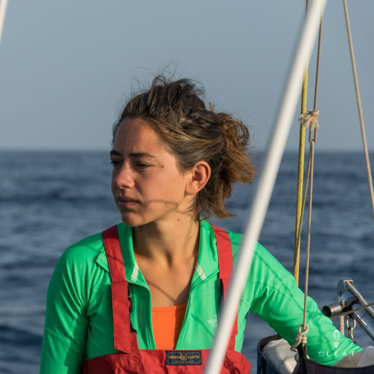 Sailing girl on the ocean