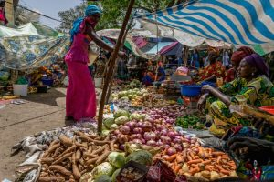 Colourful market in Senegal where women sell fruits and vegetables