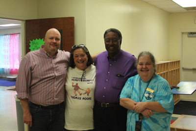 From left, educational journalist Alan Richard; Sandra Brown Turner, Lipman School director; Dr. Moore; and Carol Cordeau Young, senior supervising teacher at the University of Memphis Barbara K. Lipman Early Childhood School and Research Institute. Photo courtesy Sandra Brown Turner.